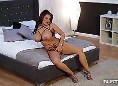 Busty seduction Katie T. masturbates with huge glass dildo until she cums