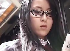 Japanese schoolgirl with glasses get fucked on bus