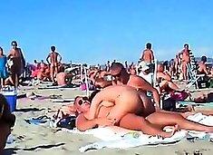 Amateur swingers enjoying hardcore group sex on the beach