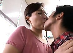 Mature Asian wife stuffing her hungry snatch with young meat