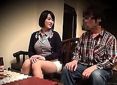 Voluptuous Oriental babe working her magic on a meat stick