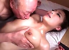 Stacked Asian wife has two horny old guys sharing her pussy