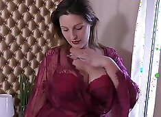 Fat woman in dark red, erotic lingerie is playing with her sex toys, in her bed